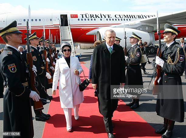 Turkey's President Recep Tayyip Erdogan and his wife Emine Erdogan attend an official welcome ceremony at the airport in Ljubljana Slovenia March 30...