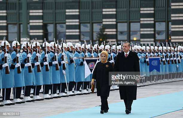 Turkey's President Recep Tayyip Erdogan and his wife Emine Erdogan are seen during an official welcoming ceremony for Ivory Coast's President...