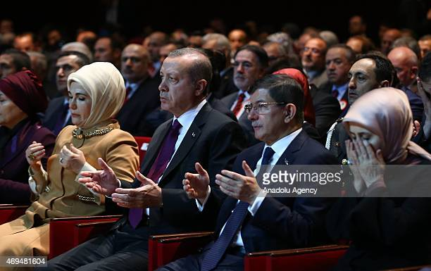Turkey's President Recep Tayyip Erdogan and his wife Emine Erdogan Turkish Prime Minister Ahmet Davutoglu and his wife Sare Davutoglu pray during a...