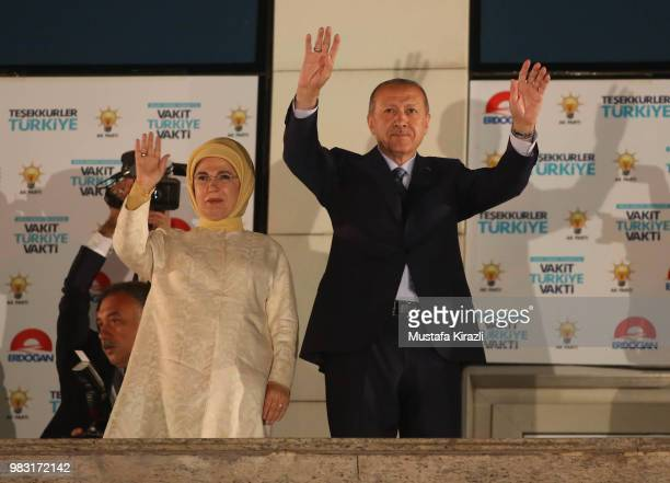 Turkey's President Recep Tayyip Erdogan and his wife Emine Erdogan greet supporters gathered in front of the AK Party headquarters on June 25 2018 in...