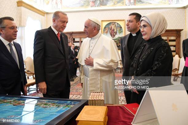 Turkey's President Recep Tayyip Erdogan and his wife Emine exchange gifts with Pope Francis during a private audience on February 5 2018 at the...