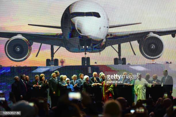Turkey's President Recep Tayyip Erdogan and officials press a button to start a virtual plane take off during the official opening ceremony of...