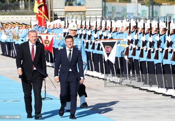 Turkey's President Recep Tayyip Erdogan and Ukraine's President Volodymyr Zelensky review a guard of honor during an official welcoming ceremony at...