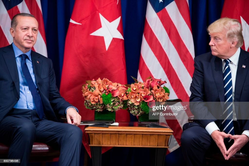 Turkey's President Recep Tayyip Erdogan and US President Donald Trump wait for a meeting at the Palace Hotel during the 72nd United Nations General Assembly September 21, 2017 in New York City. / AFP PHOTO / Brendan Smialowski