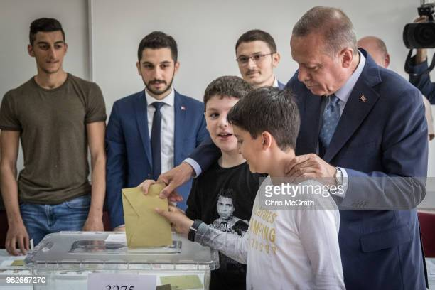 Turkey's President Recep Tayyip Erdogan casts his vote with his grandsons in the countries parliamentary and presidential election on June 24 2018 in...