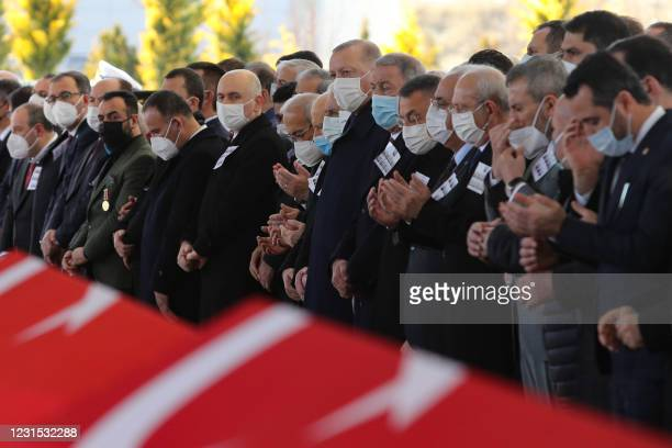 Turkey's President Recep Tayyip Erdogan , flanked by Turkish leaders, army commanders and relatives, prays during the funeral ceremony of Turkish...