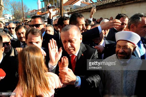 Turkey's President Recep Tayyip Erdogan high fives a young girl on December 8 2017 in the Komotini northeast Greece Turkish President Recep Tayyip...