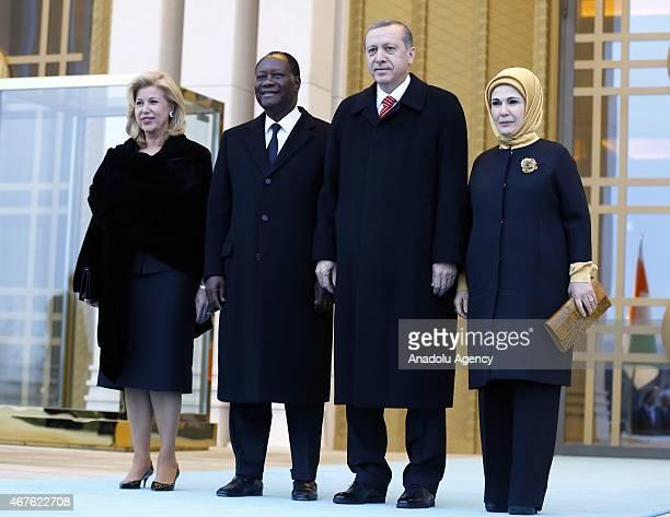 Turkey's President Recep Tayyip Erdogan his wife Emine Erdogan Ivory Coast's President Alassane Ouattara and his wife Dominique Ouattara pose during...