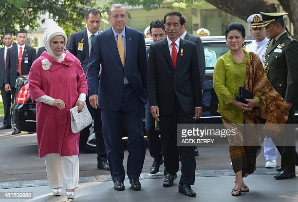 Turkey's President Recep Tayyip Erdogan his wife Emine Erdogan Indonesia's President Joko Widodo and his wife Iriana Joko Widodo walk during...