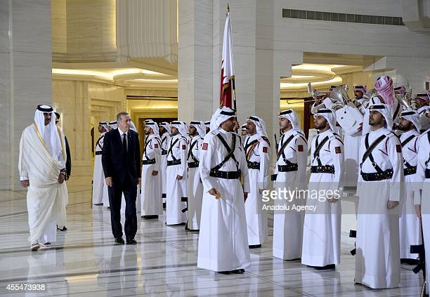 Turkeys President Recep Tayyip Erdogan is welcomed with an official ceremony by Qatar's emir Sheikh Tamim bin Hamad Al Thani at the royal palace in...