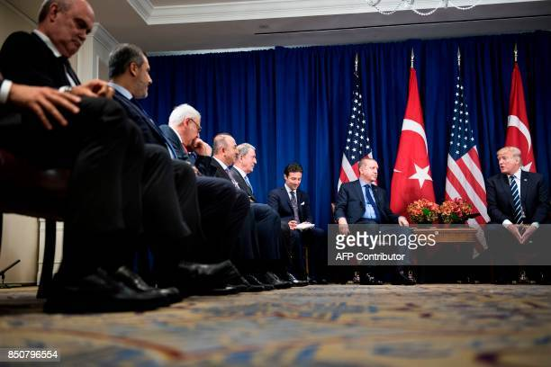 Turkey's President Recep Tayyip Erdogan listens as US President Donald Trump makes a statement for the press before a meeting at the Palace Hotel...