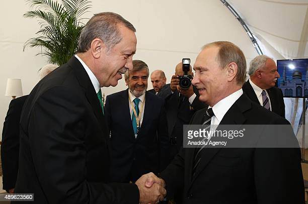 Turkey's President Recep Tayyip Erdogan meets Russian President Vladimir Putin as they attend the opening ceremony of the Moscow Central Mosque in...