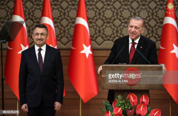 Turkey's President Recep Tayyip Erdogan presents Turkey's news Vice President Fuat Oktay during a news conference at the Presidential Palace in...