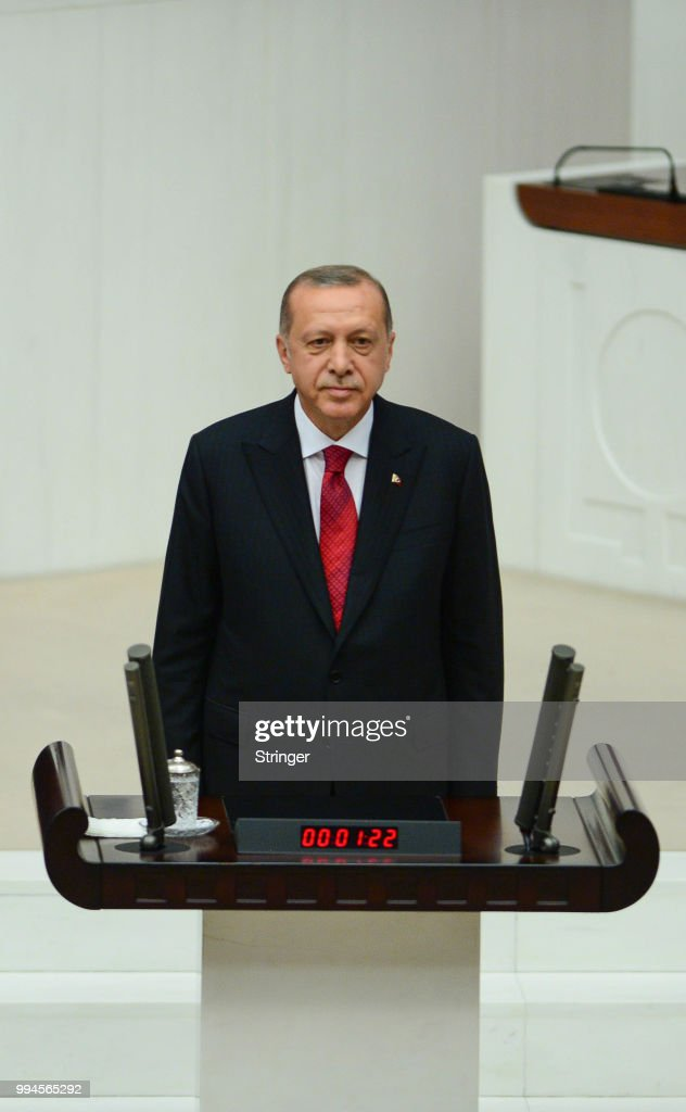 Turkey's President Recep Tayyip Erdogan receives his oath as he is sworns as Turkey's first Executive President at the Turkish parliament on July 9, 2018 in Ankara, Turkey. President Erdogan was sworn in during a parliamentary meeting and later an inauguration ceremony attended by a number of foreign leaders and dignitaries. President Erdogan secured another five year term and increased powers after winning 52.5 percent of the vote in the June 24 snap presidential and parliamentary elections. Under the new presidential system Erdogan will have the power to dissolve parliament, appoint or remove vice-presidents, ministers, judges and high level officials as well as issue executive decrees and lift or impose a state of emergency. Turkey has been under a state of emergency since the July 2016 failed coup attempt and since then the government has arrested, sacked and detain over 100,000 people said to be supporters of religious leader Fethullah Gulen. Erdogan announced that the current state of emergency would be lifted on July 18, 2018.