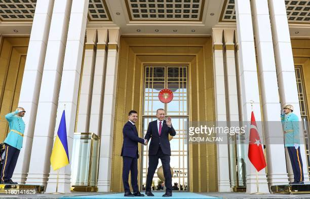 Turkey's President Recep Tayyip Erdogan shakes hand with Ukraine's President Volodymyr Zelensky during an official welcoming ceremony at the...