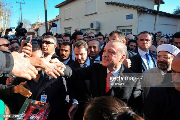 Turkey's President Recep Tayyip Erdogan shakes hands with members of the public on December 8 2017 in the Komotini northeast Greece Turkish President...