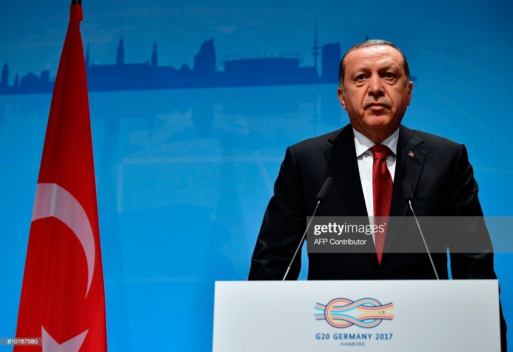 Turkey's President Recep Tayyip Erdogan speaks during the final press conference on the second day of the G20 Summit in Hamburg, Germany, July 8, 2017. Leaders of the world's top economies gather from July 7 to 8, 2017 in Germany for likely the stormiest G20 summit in years, with disagreements ranging from wars to climate change and global trade. / AFP PHOTO / Tobias SCHWARZ