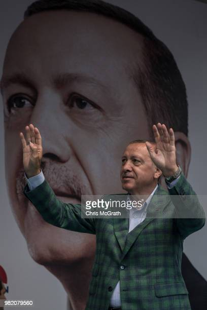 Turkey's President Recep Tayyip Erdogan waves to the crowd after arriving at an AK Parti election rally in Eyup on June 23 2018 in Istanbul Turkey...