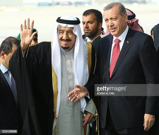 Turkey's President Recep Tayyip Erdogan welcomes Saudi King Salman bin Abdulaziz Al Saud upon his arrival at Esenboga Airport in Ankara on April 11...