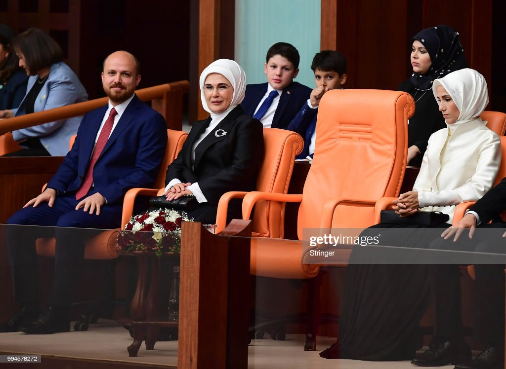Turkey's President Recep Tayyip Erdogan's his son Bilal Erdogan (L), his wife Emine Erdogan (center), his daughter Sumeyye Bayraktar (R) watch the oath taking ceremony at the Turkish parliament on July 9, 2018 in Ankara, Turkey. President Erdogan was sworn in during a parliamentary meeting and later an inauguration ceremony attended by a number of foreign leaders and dignitaries. President Erdogan secured another five year term and increased powers after winning 52.5 percent of the vote in the June 24 snap presidential and parliamentary elections. Under the new presidential system Erdogan will have the power to dissolve parliament, appoint or remove vice-presidents, ministers, judges and high level officials as well as issue executive decrees and lift or impose a state of emergency. Turkey has been under a state of emergency since the July 2016 failed coup attempt and since then the government has arrested, sacked and detain over 100,000 people said to be supporters of religious leader Fethullah Gulen. Erdogan announced that the current state of emergency would be lifted on July 18, 2018.