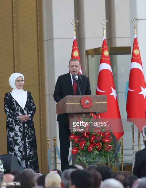 Turkey's President Tayyip Erdogan accompanied by his wife Emine Erdogan makes a speech during a ceremony at the Presidential Palace on July 9 2018 in...