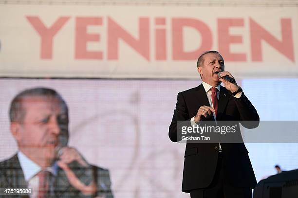 Turkey's President Tayyip Erdogan addresses his supporters during a ceremony to mark the 562nd anniversary of the conquest of the city by Ottoman...