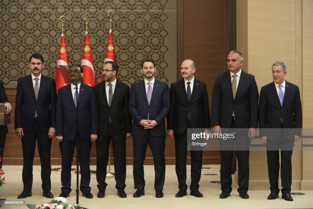 Turkey's President Tayyip Erdogan announces the new ministers of his cabinet during a press conference at the Presidential Palace on July 9, 2018 in Ankara, Turkey. Erdoan appointed Chief of General Staff Gen. Hulusi Akar (R) as the new defense minister and his son-in-law Berat Albayrak (center) as the Treasury and Finance Minister in a 16-seat surprise cabinet with not much known bureaucratic figures, hours after he was sworn into office on July 9. Erdogan secured another five year term and increased powers after winning 52.5 percent of the vote in the June 24 snap presidential and parliamentary elections. Turkey has been under a state of emergency since the July 2016 failed coup attempt and since then the government has arrested, sacked and detain over 100,000 people said to be supporters of religious leader Fethullah Gulen. Erdogan announced that the current state of emergency would be lifted on July 18, 2018.