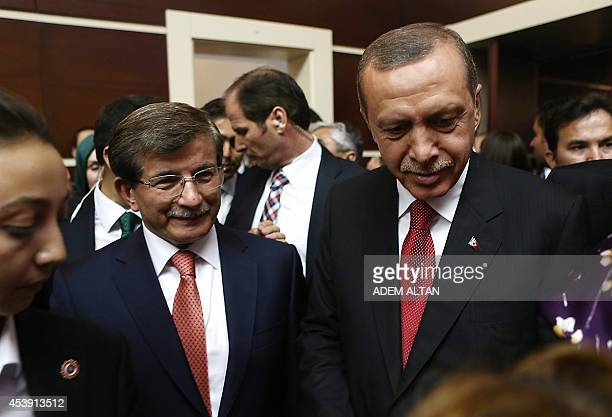 Turkey's presidentelect Recep Tayyip Erdogan and Foreign Minister Ahmet Davutoglu arrive for a Justice and Development Party meeting in Ankara on...
