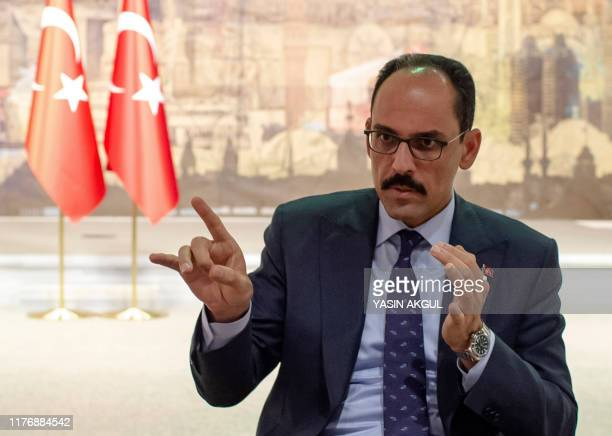 Turkey's Presidential Spokesperson brahim Kaln gestures as he speaks during an interview with AFP on October 19 2019 in Istanbul Turkey on Saturday...