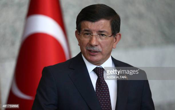Turkey's Prime Minister Ahmet Davutoglu gives a statement on the situation with the Islamic State and other militant groups during a press conference...