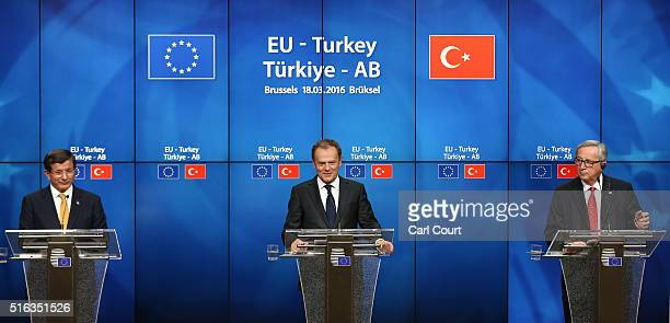 Turkey's Prime Minister Ahmet Davutoglu President of the European Council Donald Tusk and President of the European Commission JeanClaude Juncker...