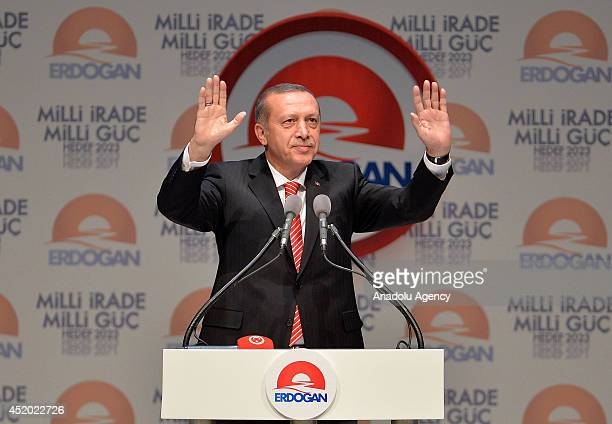 Turkey's Prime Minister and presidential candidate Recep Tayyip Erdogan greets his supporters while announcing his election manifesto and 'vision...