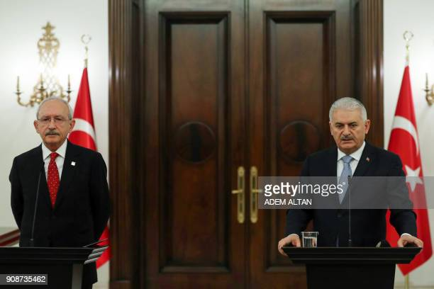 Turkey's Prime Minister Binali Yildirim and Turkey's main opposition Republican People's Party leader Kemal Kilicdaroglu give a joint press...