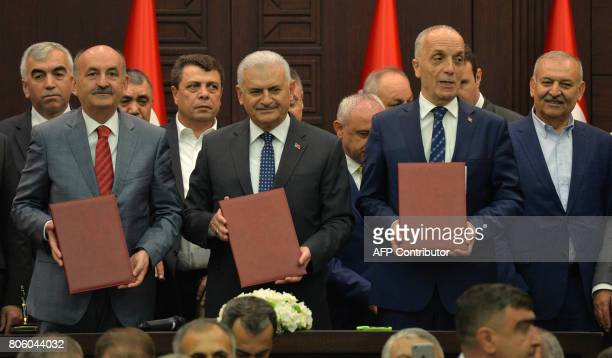 Turkey's Prime Minister Binali Yildirim , Minister of Labour and Social Security Mehmet Müezzinoglu , and Confederation of Turkish Trade Unions...