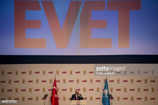 Turkey's Prime Minister Binali Yildirim speaks under the word 'Evet' during a rally officially opening the AKP Party 'Yes' constitutional referendum...