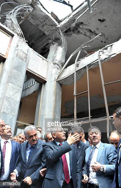 Turkey's Prime Minister Binali Yildirim visits damaged parts of the Turkish parliament in Ankara, on July 19, 2016 in the aftermath of a failed coup...
