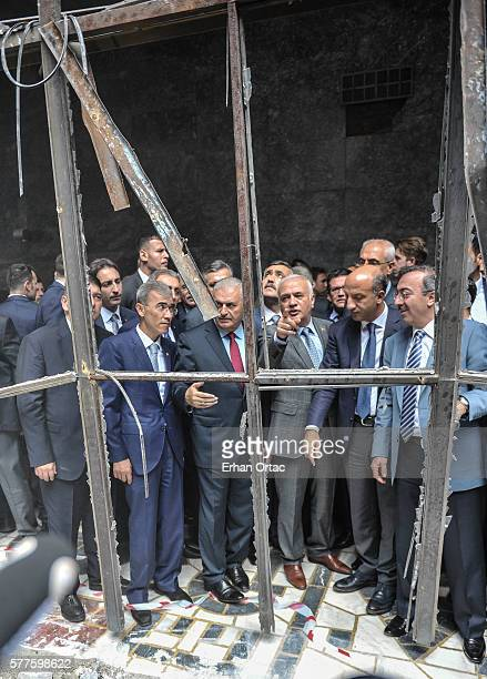 Turkey's Prime Minister Binali Yildrim visits damaged parts of the Turkish parliament on July 19, 2016 in Ankara, Turkey. Clean up operations are...
