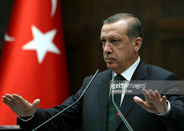 Turkey's Prime Minister Recep Tayyip Erdogan addresses members of parliament from his ruling AK Party during a meeting at the Turkish parliament in...
