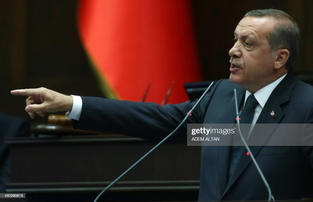 Turkey's Prime Minister Recep Tayyip Erdogan addresses members of the Turkish Parliament from his ruling AK Party (AKP) during a meeting at the Turkish parliament in Ankara on May 20, 2014.