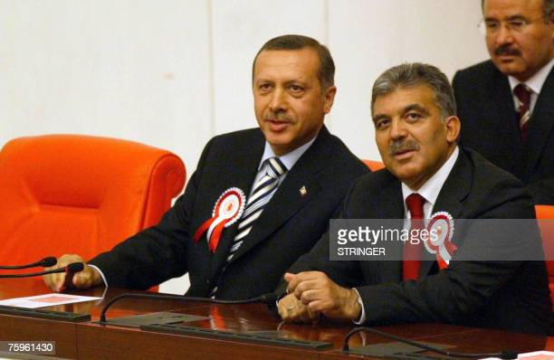 Turkey's Prime Minister Recep Tayyip Erdogan and Foreign Minister Abdullah Gul attend the first session of the coutry's new Parliament 04 August...