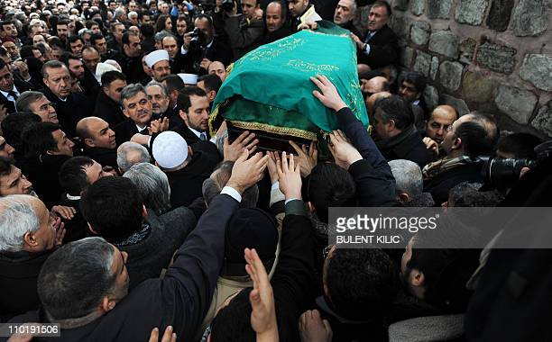 Turkey's Prime Minister Recep Tayyip Erdogan and President Abdullah Gul look at people as they carry the coffin of late Prime Minister Necmettin...