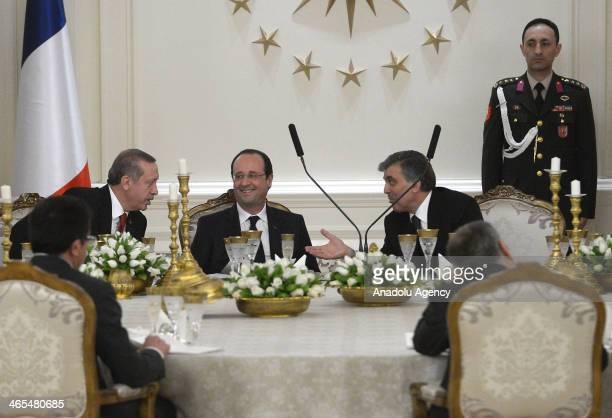 Turkey's Prime Minister Recep Tayyip Erdogan and President of Turkey Abdullah Gul speak during the dinner in honor of President of France Francois...