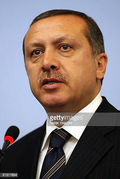 Turkey's Prime Minister Recep Tayyip Erdogan holds a press conference at his party headquarters in Ankara, 17 September 2004. Erdogan warned the...