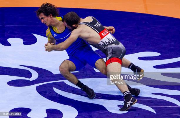 Turkeys Rahman Bilici and Egypts Hassan Hassan Ahmed Mohamed compete during the final of mens Greco Roman 63 kg category at the World Wrestling...