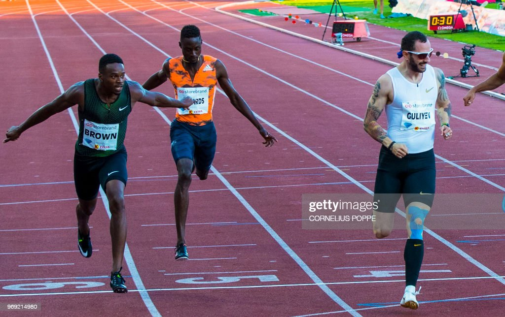 Turkey's Ramil Guliyev (R) celebrates winning the Men's 200m next to third placed Jereem Richards (C) from Trinidad Tobago and Canada's Aaron Brown during the IAAF Diamond League 2018 Bislett Games on June 7, 2018 at Bislett Stadium in Oslo, Norway. (Photo by Cornelius POPPE / NTB Scanpix / AFP) / Norway OUT