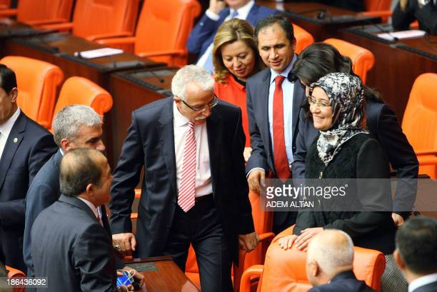 Turkey's ruling Justice and Development Party MP Gulay Samanci is greeted as she attends a general assembly wearing a headscarf at the Turkish...