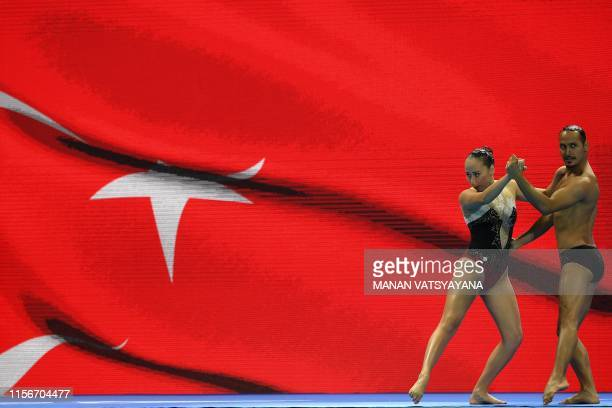 Turkey's Rumeysa Unal and Gokce Akgun compete in the mixed duet free artistic swimming final during the 2019 World Championships at Yeomju Gymnasium...