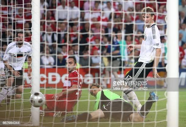 Turkey's Semih Senturk scores his sides second goal of the game past Germany goalkeeper Jens Lehmann