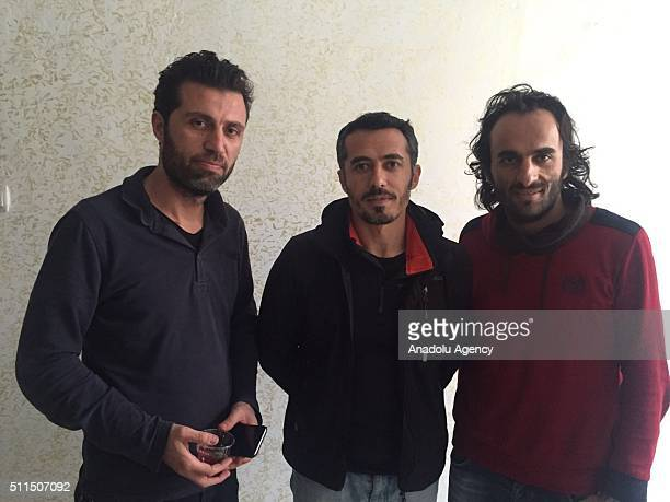 Turkey's semi-official news agency, Anadolu Agency journalists , Onur Coban, Kenan Yesilyurt and Rauf Maltas pose at the district's police...
