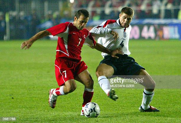 Turkey's Sergen Yalcin fights for the ball with England`s Steven Gerrard during their Euro 2004 qualifying match at Sukru Saracoglu stadium in...